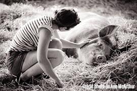 Sarah and piggy at Farm Sanctuary, NY, USA.